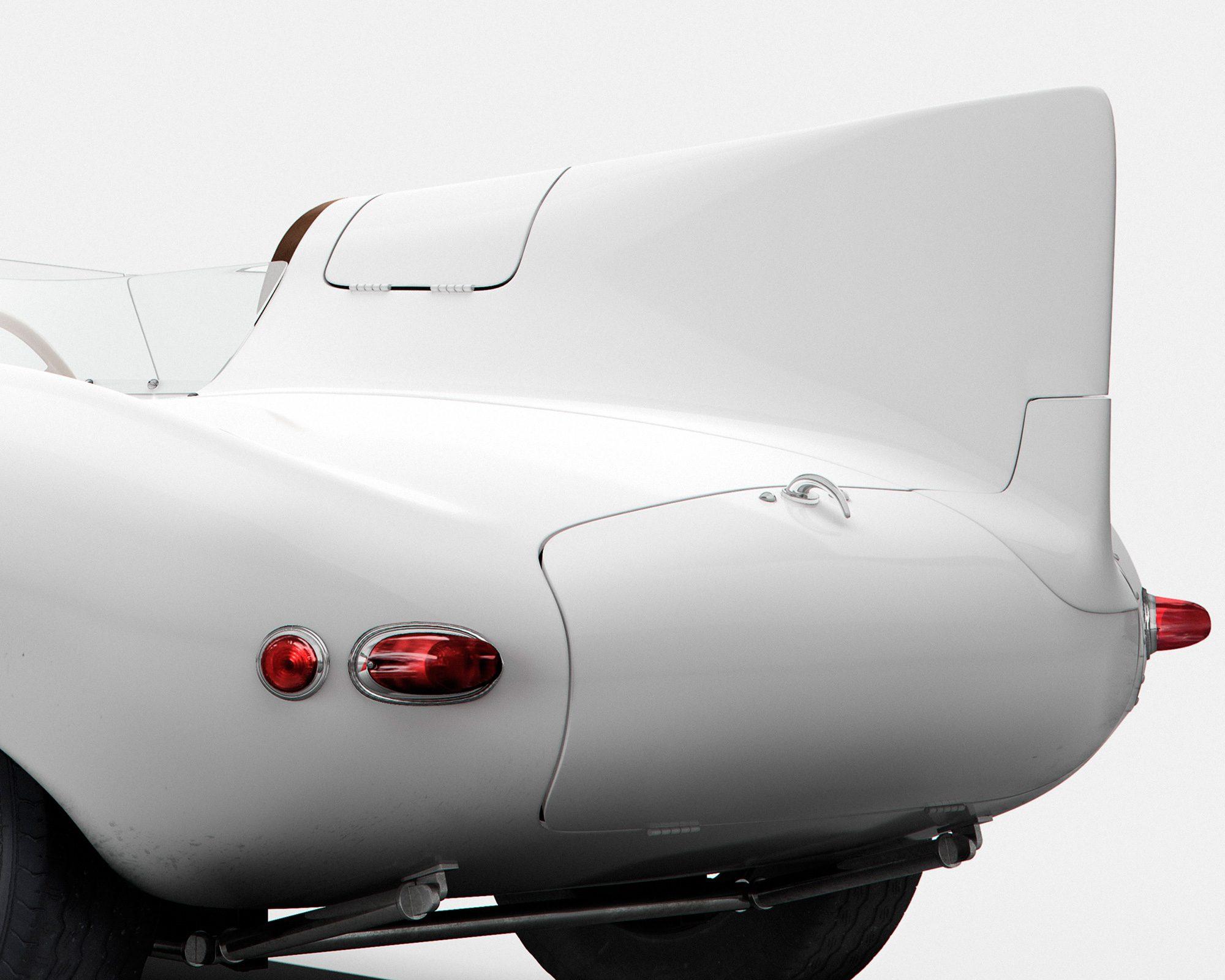 Белый автомобиль Jaguar D-Type